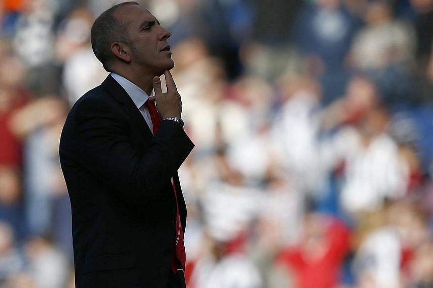 Sunderland's manager Paolo Di Canio gestures to fans after their English Premier League soccer match against West Bromwich Albion at The Hawthorns in West Bromwich, central England, September 21, 2013. Sunderland chief executive Margaret Byrne s