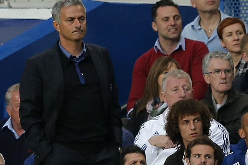 Chelsea manager Jose Mourinho (left) watches the game with David Luiz (top right) and Juan Mata in the stands during their English Premier League soccer match against Fulham at Stamford Bridge in London on Sept 21, 2013. Mourinho handed Mata a rare s