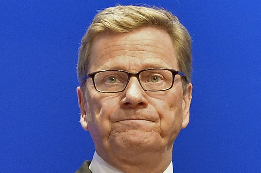 German Foreign Minister Guido Westerwelle, board member of the Free Democratic party FDP looks from the podium at the Free Democratic party (FDP) election event in Berlin, Sunday, Sept. 22, 2013.German Foreign Minister Guido Westerwelle welcome