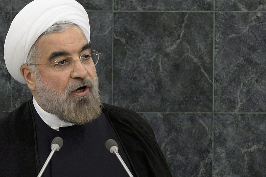 Iranian President Hassan Rouhani addresses the 68th United Nations General Assembly, at UN headquarters in New York, on Sept 24, 2013.Mr Rouhani blasted international sanctions against Iran on Tuesday, comparing them to the widely criticised pu