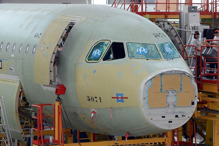 An Airbus A320 plane is seen under construction on the assembly line of an Airbus factory in the northern port city of Tianjin on June 13, 2012.Airbus has secured commitments for more than 40 of its A320 family of aircraft from two new Chinese