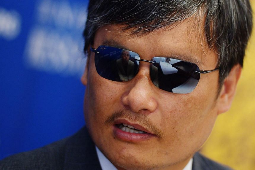 Chinese political dissident Chen Guangcheng urged US President Barack Obama on Tuesday, Sept 24, 2013, to raise the continued harassment of his family with Chinese authorities. -- PHOTO: AFP
