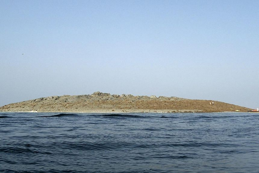An island that rose from the sea following an earthquake is pictured off Pakistan's Gwadar coastline in the Arabian Sea on Wednesday, Sept 25, 2013. -- PHOTO: REUTERS
