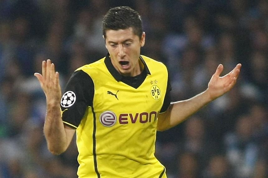 Borussia Dortmund striker Robert Lewandowski hopes to join Bayern Munich in January when he will be eligible to sign a pre-contract agreement with any football club of his choice. -- FILE PHOTO: AFP