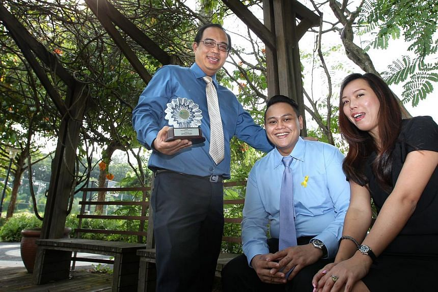 Former inmate Abu Bakar (centre) with supervisor and pastry chef Mr Eng and Marina Mandarin hotel director of marketing communications Patricia Yong. He had zero experience when he started work at the hotel as a cook, but was willing to seek help and