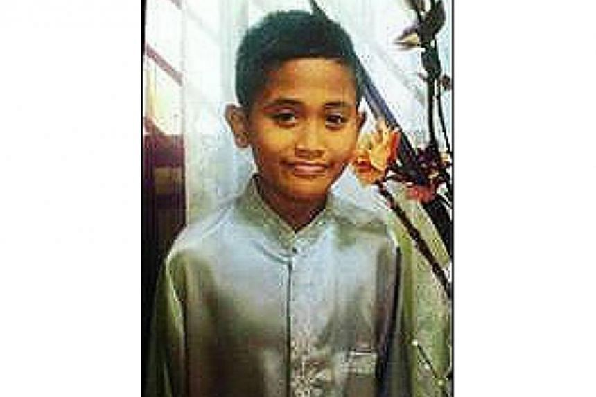 The police are appealing for information on the whereabouts of 12-year-old Muhammad Suhaizal Suhaimi, who was last seen at Block 102, Woodlands St 13 on Sept 6 at about 6.30am. -- PHOTO: SPF