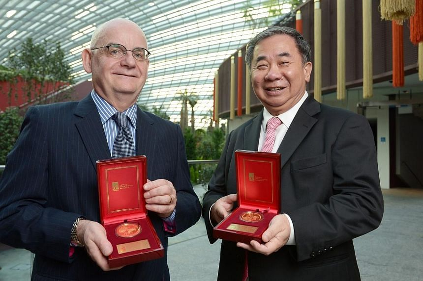 Professor Barry Halliwell (left) of the National University of Singapore and Nanyang Technological University's Professor Freddy Boey both received the President's Science and Technology Medal from President Tony Tan Keng Yam on Wednesday, Sept 25, 2
