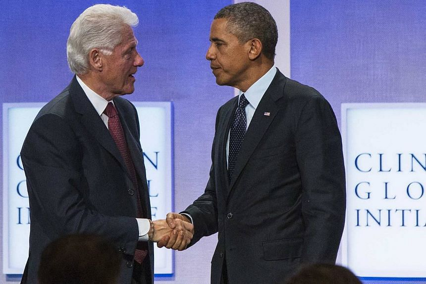 Former United States President Bill Clinton shakes hands with President Barack Obama after a discussion about healthcare at the Clinton Global Initiative (CGI) in New York on Sept 24, 2013. Mr Obama teamed up with Mr Clinton and Mrs Hillary Clinton o