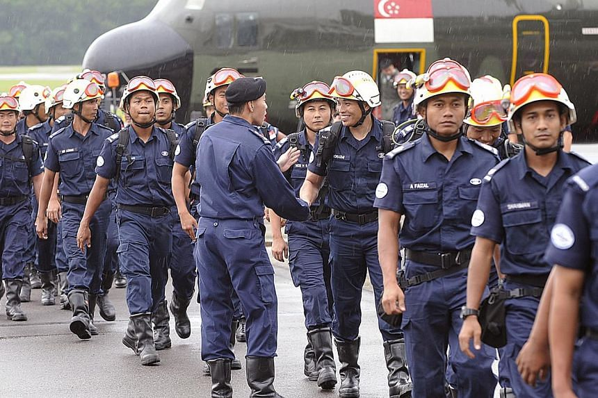 Thirty-nine members of the Operation Lionheart contingent from the Singapore Civil Defence Force (SCDF), tasked with rescue efforts in quake-struck Padang in Indonesia, returned home on Oct 8, 2009. The SCDF will be be adding more men to Operation Li