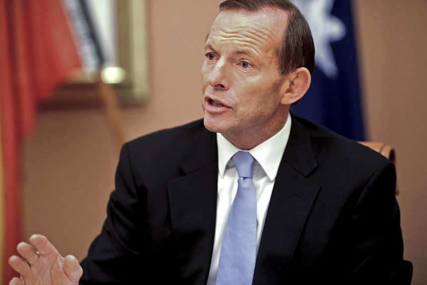 Australia's new Prime Minister Tony Abbott attends the first meeting of the full ministry at Parliament House in Canberra, on Wednesday, Sep 18, 2013. Australia's new Prime Minister Tony Abbott played down Indonesian opposition to his controversial r