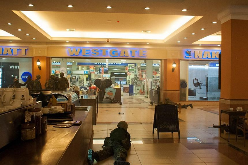 """Kenyan troops take position on Sept 21, 2013 inside the Westgate mall in Nairobi.The Nairobi mall carnage in which several foreigners were killed by Islamist fighters was a """"message to Westerners"""" who supported Kenya, Somalia's Shebab chief sai"""