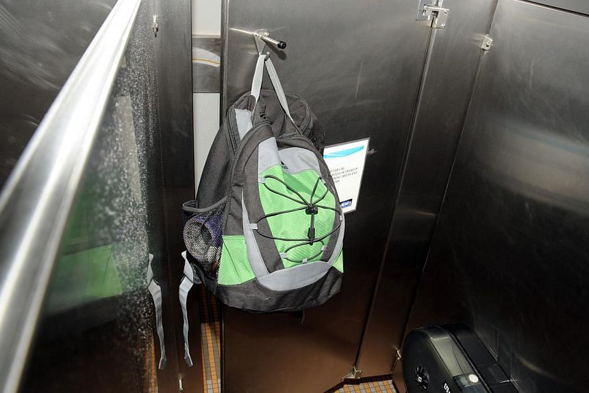 This image from video provided by the FBI, shows Aaron Alexis' backpack that was found hanging on the back of a bathroom stall door in the fourth-floor men's bathroom in building #197 at the Washington Navy Yard on Monday, Sept. 16, 2013, in Washingt