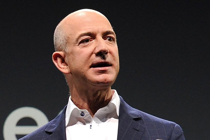 Jeff Bezos CEO of Amazon speaks during a press conference in this Sept 6, 2012 file photo in Santa Monica, California. Amazon chief executive and new Washington Post owner Jeff Bezos said on Wednesday that print newspapers could one day become a luxu