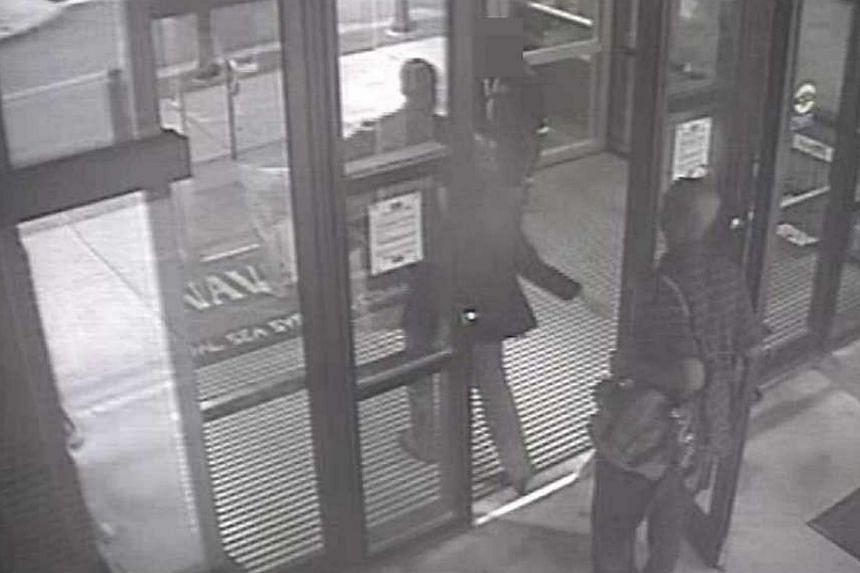 Aaron Alexis enters Building #197 at 8:08 a.m., carrying a backpack, in this undated handout photo released by the FBI.The FBI said Alexis believed electromagnetic waves had been controlling him for months before the rampage that killed 12 peop