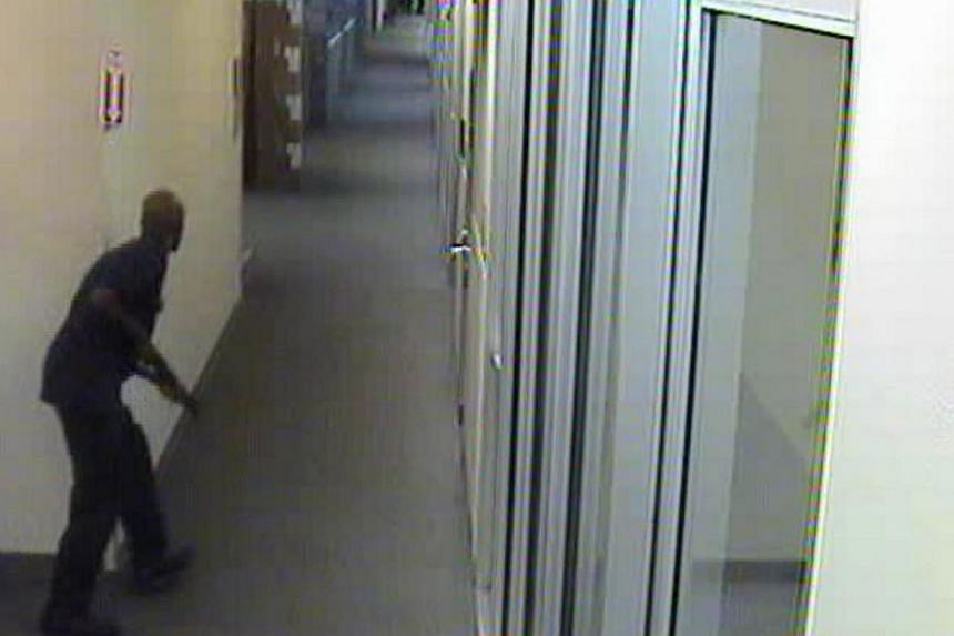 Aaron Alexis moves through the hallways of Building #197 carrying a Remington 870 shotgun in this undated handout photo released by the FBI.The FBI said Alexis believed electromagnetic waves had been controlling him for months before the rampag