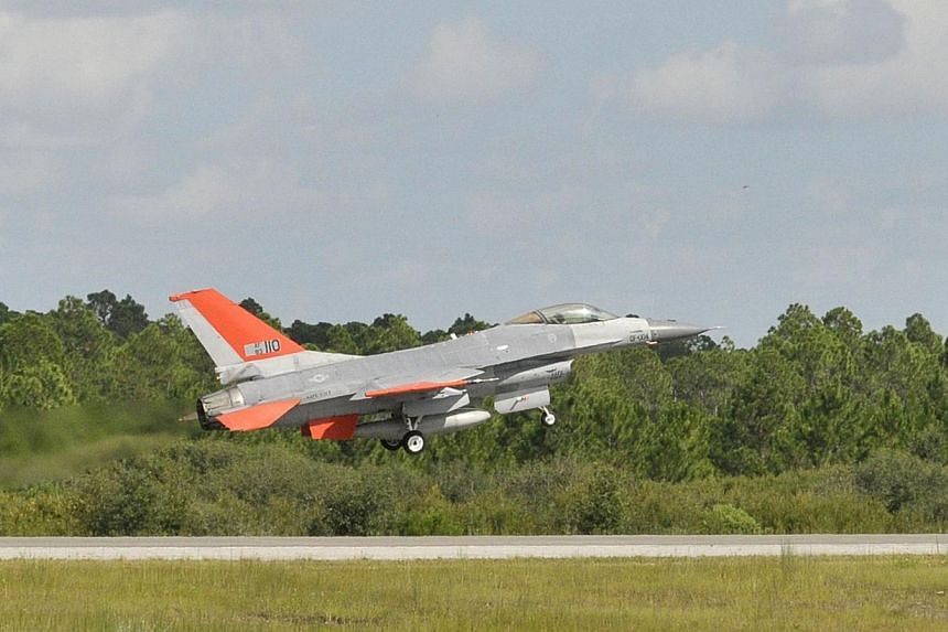 This Sept 23, 2013 handout image provided by aerospace giant Boeing, shows the QF-16, which is a retired F-16 jet modified to be an aerial target, on take-off during a test flight near Tyndall Air Force Base in Florida. The US Air Force has test flow