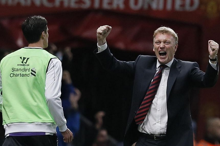 Manchester United manager David Moyes (right) celebrates a goal against Liverpool during their English League cup football match at Old Trafford in Manchester, northern England on Sept 25, 2013. Manchester United manager David Moyes spoke of how he f