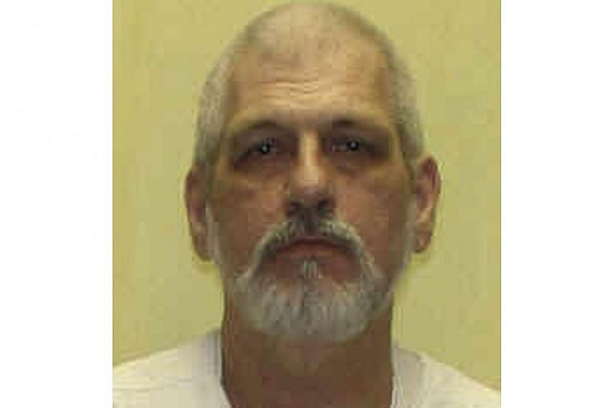 This undated file photo released by the Department of Rehabilitation and Corrections shows Harry Mitts. Mitts, a white gunman who spewed racial slurs before fatally shooting a black man and a police officer in a 1994 rampage was executed in Ohio on W
