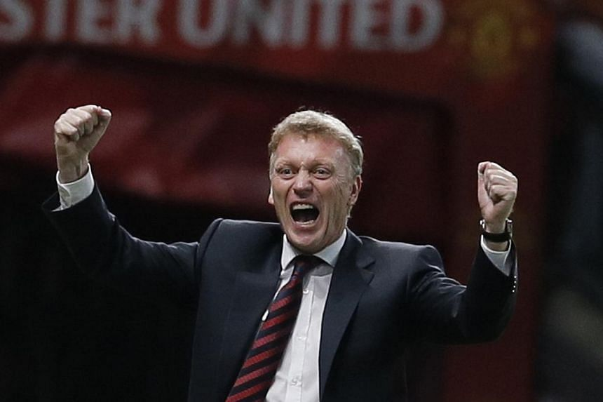 Manchester United manager David Moyes celebrates a goal against Liverpool during their English League cup soccer match at Old Trafford in Manchester, northern England on Sept 25, 2013. Manchester United's reward for beating bitter rivals Liverpool in