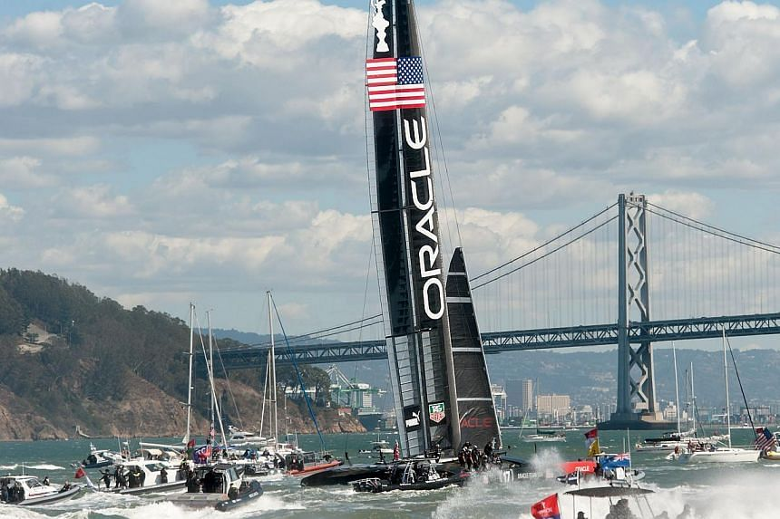 Fleet and spectator boats follow Oracle Team USA as it celebrates its victory over Emirates Team New Zealand in the 34th America's Cup on Sept 25, 2013, in San Francisco. -- PHOTO: AFP