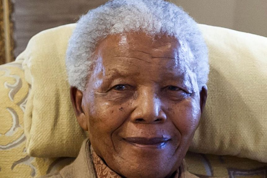 Global anti-apartheid icon Nelson Mandela during a visit by former US president on July 17, 2012, at his home in Qunu, Eastern Cape, on the eve of his 94th birthday. Mr Mandela, who is recovering at home after spending nearly three months in hospital
