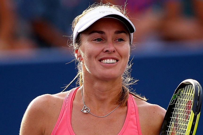The husband of former tennis champ Martina Hingis (pictured) has accused his wife and mother-in-law of assaulting him and has left Switzerland fearing for his life, the Blick daily reported on Thursday, Sept 26, 2013. -- FILE PHOTO: AFP / GETTY IMAGE