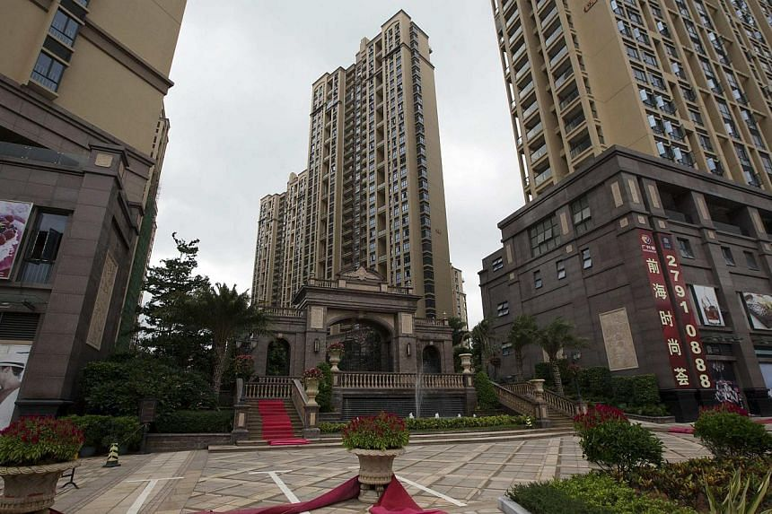 New residential buildings for sale are seen near the Qianhai special economic zone in Shenzhen on Aug 16, 2013. A planned economic zone in southern China will allow full internet freedom, similar to what will be allowed in a proposed free trade