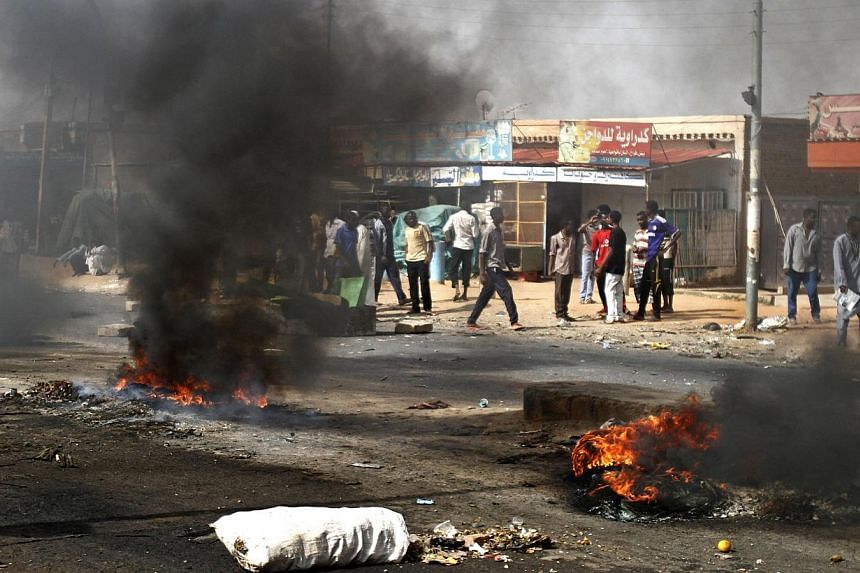 Protesters burn tires and close the highway to northern cities amid a wave of unrest over the lifting of fuel subsidies by the Sudanese government, in Kadro, 24.14km north of downtown Khartoum on Wednesday, Sept 25, 2013.At least 29 people have