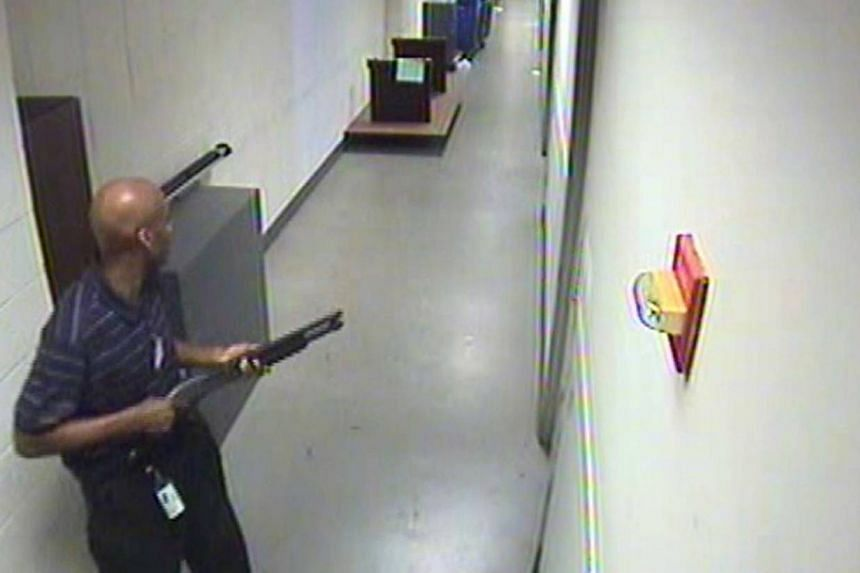 Aaron Alexis moves through the hallways of Building 197 carrying a Remington 870 shotgun in this undated handout photo released by the Federal Bureau of Investigation (FBI). The FBI said Alexis believed electromagnetic waves had been controlling him