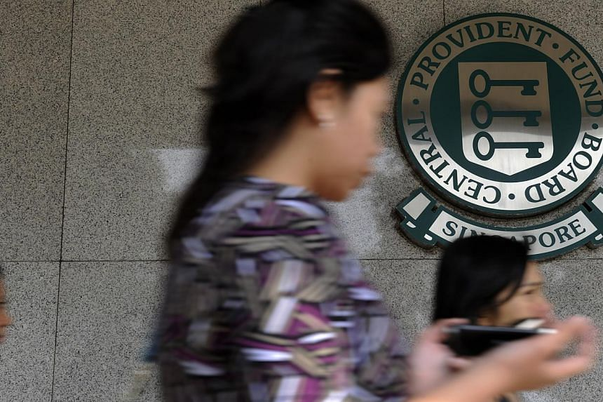 People walking past the CPF building along Shenton Way, 5 January 2012.The 4 per cent minimum interest rate on Central Provident Fund (CPF) savings in the Special, Medisave and Retirement accounts (SMRA) will be extended to Dec 31 next ye