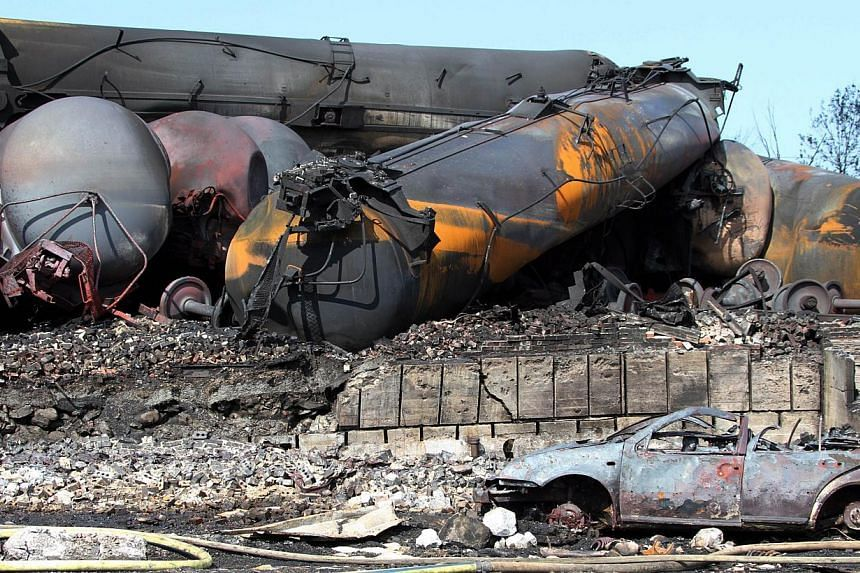 Wrecked oil tankers and debris from a runaway train that derailed and exploded in Lac-Megantic, Quebec, Canada, is seen in this photo from Surete du Quebec on July 8, 2013. The United States (US) company whose runaway oil tanker train exploded and ki