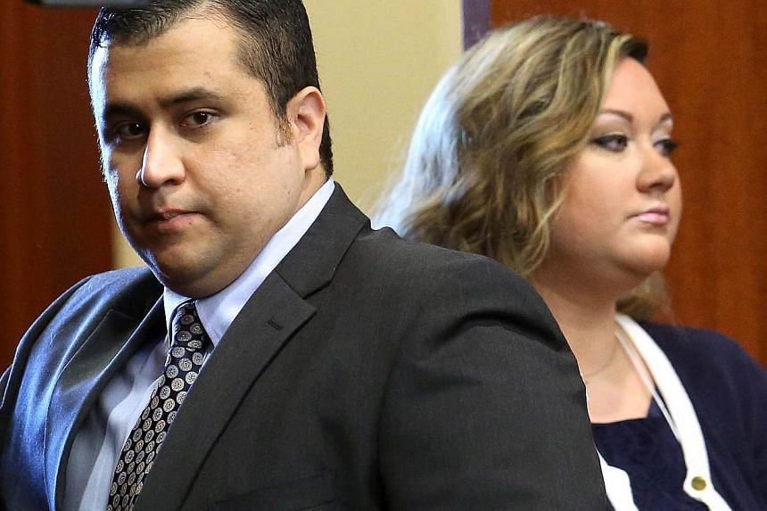 Mr George Zimmerman (left) arrives in Seminole circuit court with his wife Shellie in Sanford, Florida, on June 24, 2013. Ms Zimmerman said in an NBC TV interview on Thursday that she now doubted her estranged husband's innocence after standing by hi