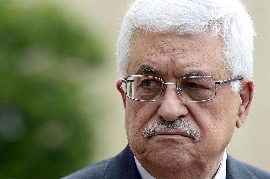 Palestine's authority president Mahmud Abbas listens to a speech by French President following their meeting on Sept 12, 2013, at the Elysee palace in Paris. Mr Abbas warned the United Nations on Thursday that United States-brokered peace talks offer