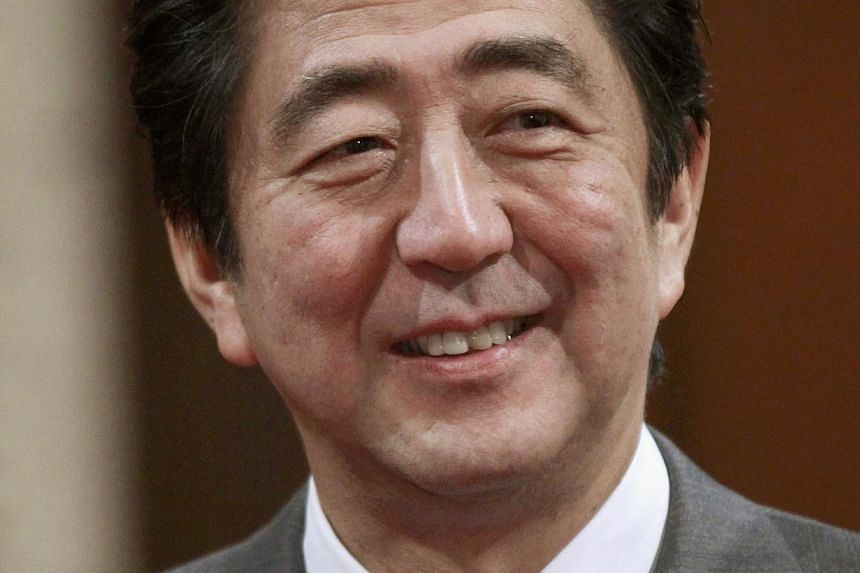 Japan's Prime Minister Shinzo Abe tours the Senate chamber on Parliament Hill in Ottawa on Sept 23, 2013. Mr Abe vowed on Thursday to work at home and abroad to improve the plight of women, in a shift of tone for the conservative leader. -- FILE PHOT
