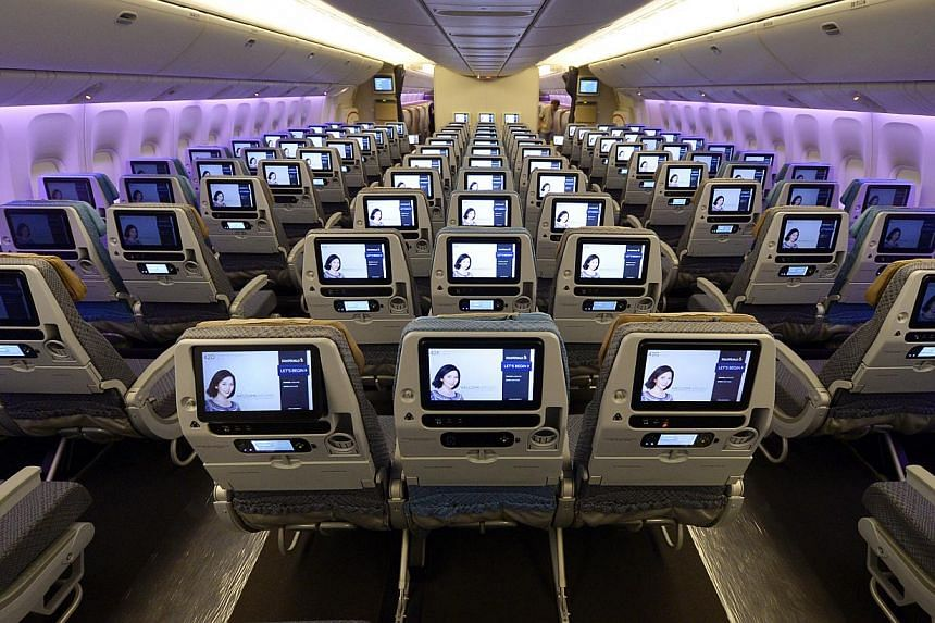 Seats in the economy class of Singapore Airlines (SIA) showing the folding screens. SIA's cabin overhaul, the most extensive since 2006, comes amidst other airlines like Garuda Indonesia, British Airways and Air France putting their new products in t