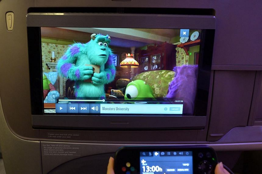 The TV screen in the business class seats of Singapore Airlines (SIA). SIA's cabin overhaul, the most extensive since 2006, comes amidst other airlines like Garuda Indonesia, British Airways and Air France putting their new products in the air. -- ST