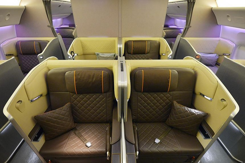 Singapore Airlines' (SIA) new first-class seats. SIA's cabin overhaul, the most extensive since 2006, comes amidst other airlines like Garuda Indonesia, British Airways and Air France putting their new products in the air. -- ST PHOTO: ALPHONSU