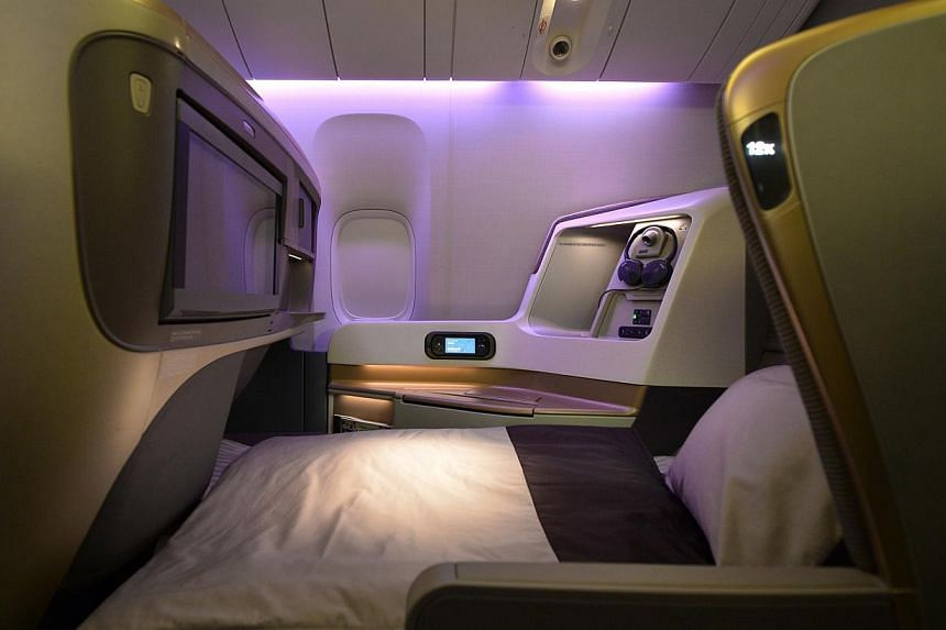 Singapore Airlines' (SIA) business class seats in the bed mode. SIA's cabin overhaul, the most extensive since 2006, comes amidst other airlines like Garuda Indonesia, British Airways and Air France putting their new products in the air. -- ST PHOTO: