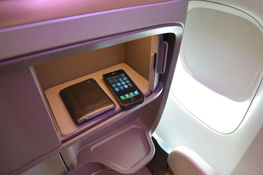 Singapore Airlines' (SIA) first class seats have a compartment for storing personal items. SIA's cabin overhaul, the most extensive since 2006, comes amidst other airlines like Garuda Indonesia, British Airways and Air France putting their new produc