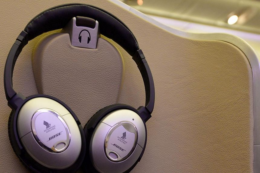 Singapore Airlines' (SIA) first class seats with Bose headphones. SIA's cabin overhaul, the most extensive since 2006, comes amidst other airlines like Garuda Indonesia, British Airways and Air France putting their new products in the air. -- ST PHOT