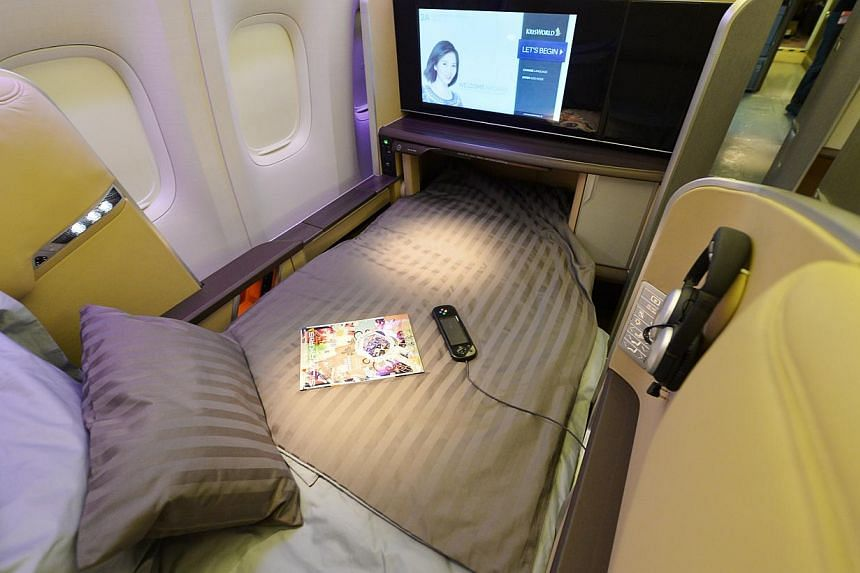 Singapore Airlines' (SIA) first class seat in bed mode. SIA's cabin overhaul, the most extensive since 2006, comes amidst other airlines like Garuda Indonesia, British Airways and Air France putting their new products in the air. -- ST PHOTO: A