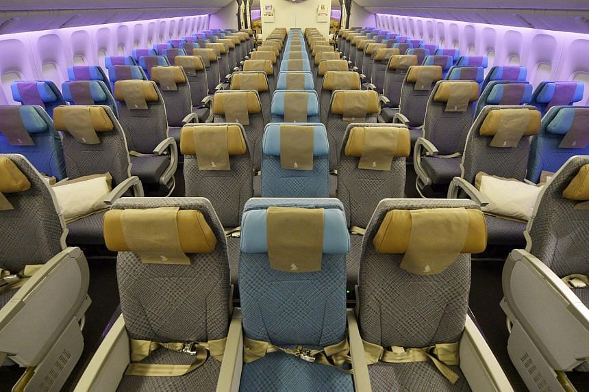Seats in the updated cabin of Singapore Airlines' (SIA) economy class. SIA's cabin overhaul, the most extensive since 2006, comes amidst other airlines like Garuda Indonesia, British Airways and Air France putting their new products in the air. -- ST