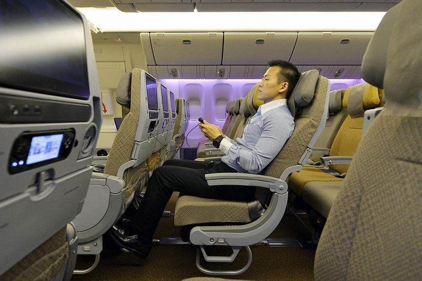 The degree of adjustability the seat is capable of is shown in this photo of Singapore Airlines' (SIA) economy class taken on Sept 25, 2013. SIA's cabin overhaul, the most extensive since 2006, comes amidst other airlines like Garuda Indonesia,