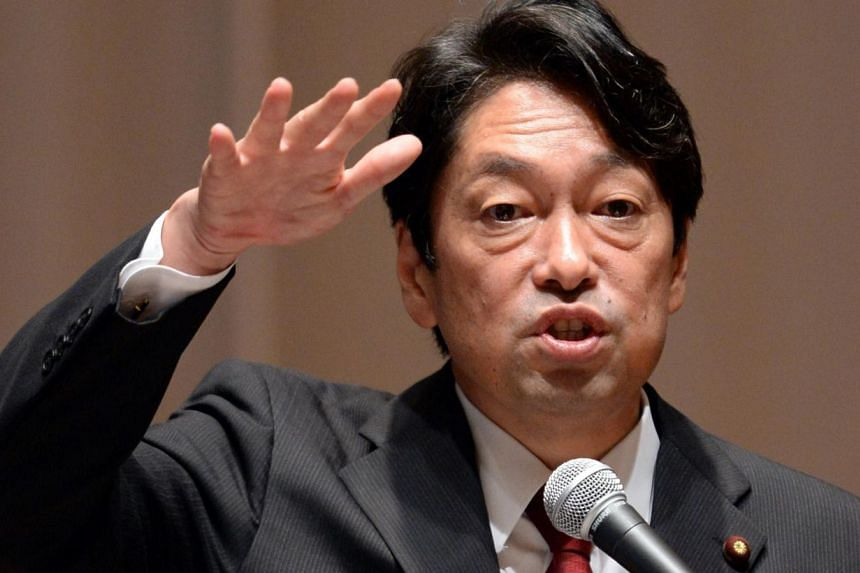 Japanese Defense Minister Itsunori Onodera gestures while answering a question during the 350th Yomiuri International Economic Society (YIES) lecture meeting in Tokyo on Sept 27, 2013. Mr Onodera said that Japan needs to expand its surveillance activ