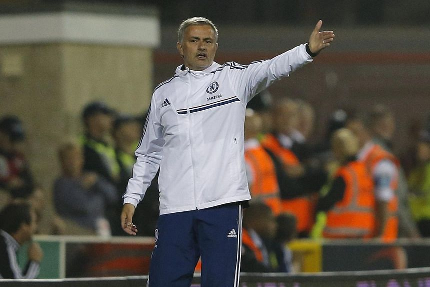 Chelsea manager Jose Mourinho insisted he was not concerned by comments made by Tottenham Hotspur manager Andre Villas-Boas about the decline of their relationship on Friday, Sept 27, 2013. -- FILE PHOTO: REUTERS