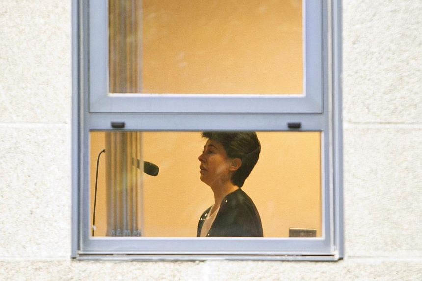 Rosario Porto speaks to judges during an audition at a court in Santiago de Compostela, on Sept 27, 2013. A Spanish judge jailed a 44-year-old mother on charges of killing her Chinese-born, 12-year-old adopted daughter on Friday, Sept 27, 2013, whose