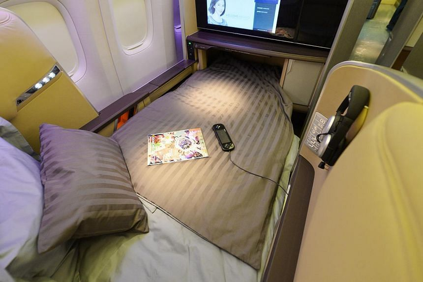 SIA's overhauled cabins include (from left) a new inflight entertainment touchscreen monitor in economy class; more storage space in the seats in business class; and first-class seats that can be turned into longer beds than before. The new cabins de