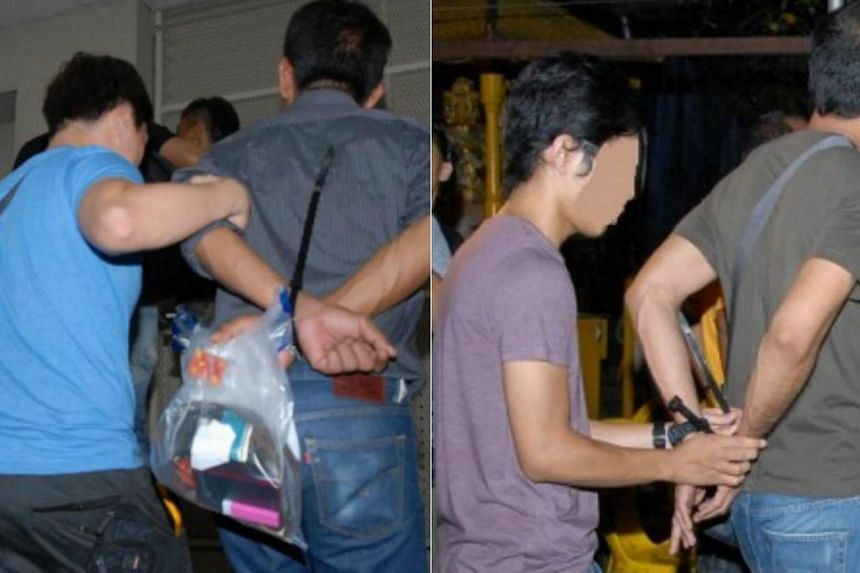 Suspects being arrested by Home Team officers. An islandwide operation conducted from over four days ended with 106 arrests and more than $100,000 worth of drugs seized.-- PHOTOS: CNB