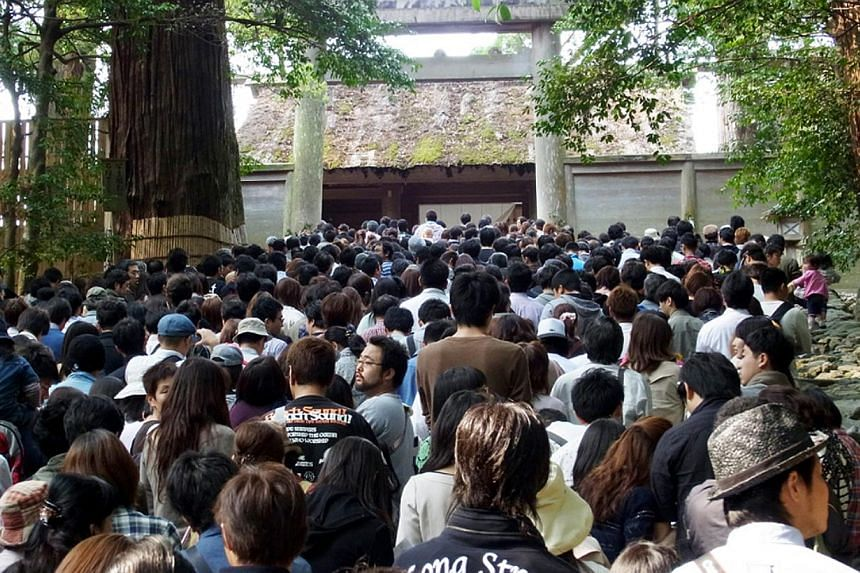 Hundreds of people surge up the steps towards the Naiku (Inner Shrine) of the Ise Grand Shrine, even on a normal day. Visitors however can only see the tops of the thatched roofs of the shrine structures, which are shielded from view by tall wooden f
