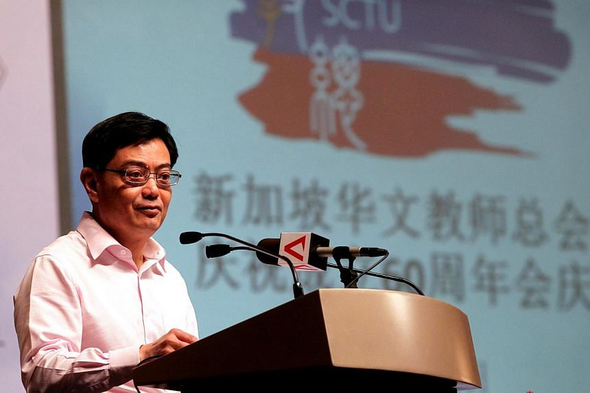 Education Minister Heng Swee Keat speaks at a Singapore Chinese Teachers' Union seminar. He said Singapore can still do more to promote the Chinese language and culture. -- ST PHOTO: CHEW SENG KIM